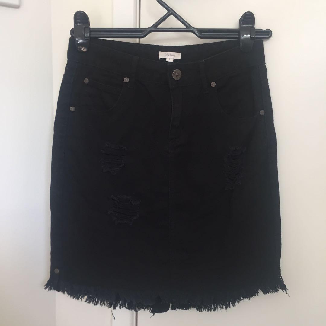 Black denim distressed mini skirt