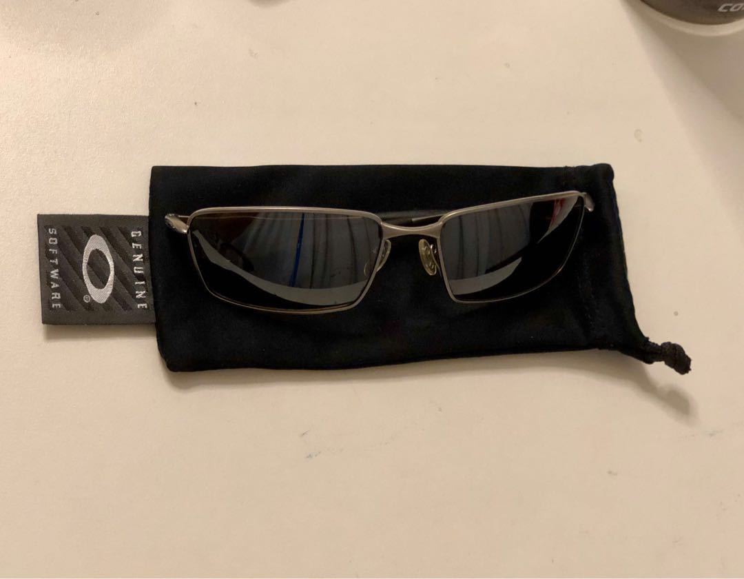 6ce2717e0ab4e Oakley titanium polarised square wire sunglass Original
