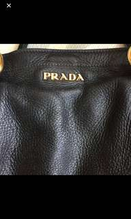 Authentic Prada Leather shoulder / crossbody bag in Black