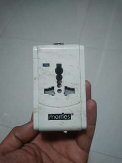 Morries travel adapter with USB socket