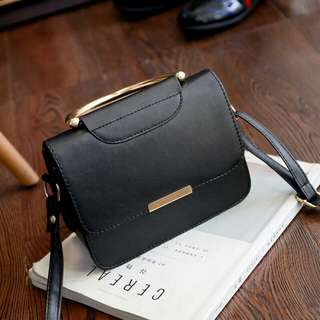 Elegant Metal Ring Handbag
