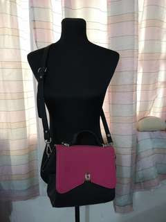 Black and pink sling bag