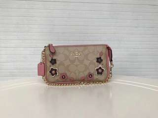 Coach Large Wristlets 19 in signature canvas with floral appliqué