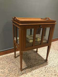 Teakwood display cabinet with detachable tray.