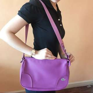 Authentic Lacoste w/ Dustbag Good As Brand New sling bag in magenta