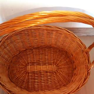 Long handle oval orange rattan basket