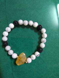 Charm bracelet with lava stone and crystal
