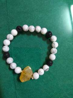 Charm bracelet with crystal and lava stone