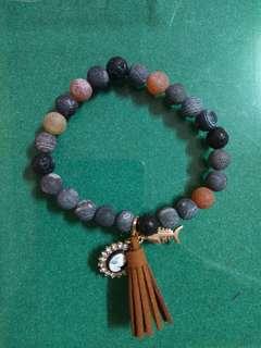 Charm bracelet with lava stone