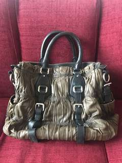 Prada olive green gaufre leather strap nappa bag