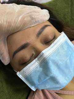 Semi permanent eyebrow make up.