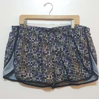 Under Armour purple/black Running Shorts (size XL)