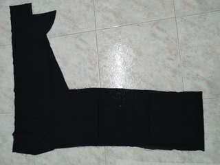 Irregular shaped black fabric- not cotton