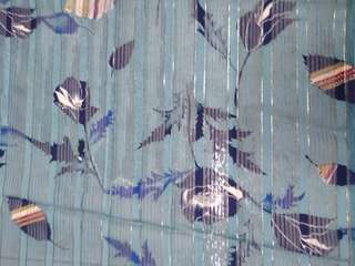 Light blue floral fabric w shiny silver stripes
