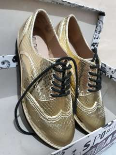 Gold Payless shoe