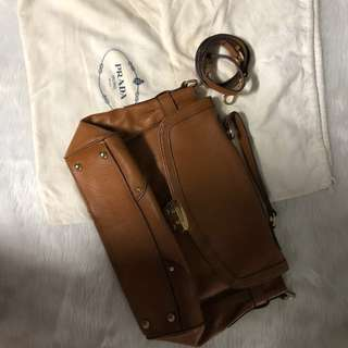 Prada brown real leather satchel with sling