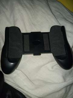 Game pad for mobile phones