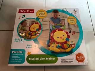 Brand new Fisher-Price Musical Lion Walker