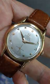 Omega 18k solid gold.