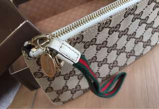 Authentic Gucci wristlet with box