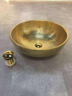 Gold colour round basin