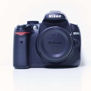 Nikon D5000 with 50mm lens (optional), memory card and day holster