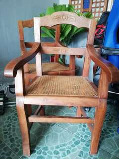 Wooden arm chair with rattan seat