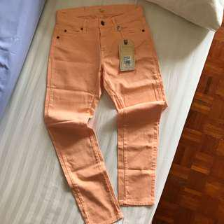 Mid rise skinny jeans in peach BNWT