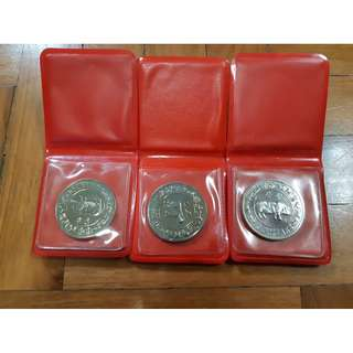🚚 1985 $10 Year of the Ox coin 1983 $10 Year of the Pig coin