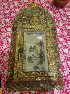 Beautiful antique mirror with enclosed coat brushes