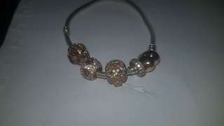 Rose gold Pandora bracelet with 4 charms