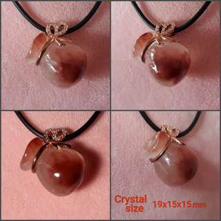 Rabbit hair Rutilated crystal pendant.(兔毛发晶吊坠) shape of money bag (钱💰袋).