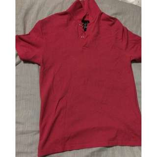 Folded and Hung pink polo shirt