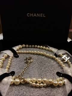 Chanel Pearl and logo charm necklace
