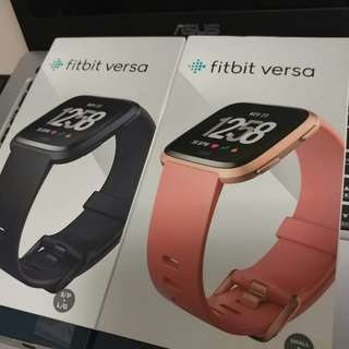 On hand items! Ready for collection. Black and Rose Peach Fitbit Versa