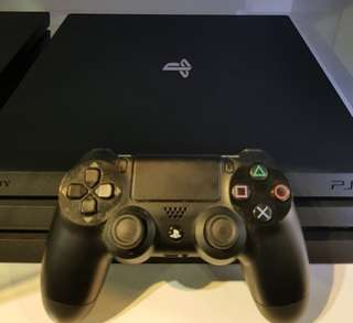 PS4 Pro 1TB with controller and games
