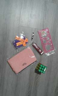 pencil case, lanyard, ruler, wallet, rubiks cube and hair clip