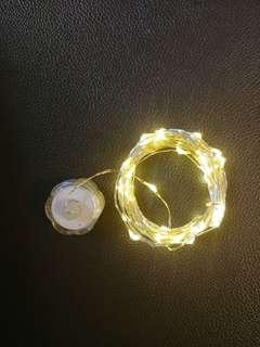 50頭LED 暧白光銅線電池燈(鈕型電*2)