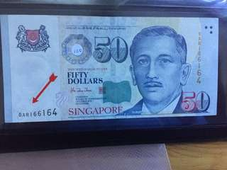 Error $50 banknote major alignment shift at the bottom base.