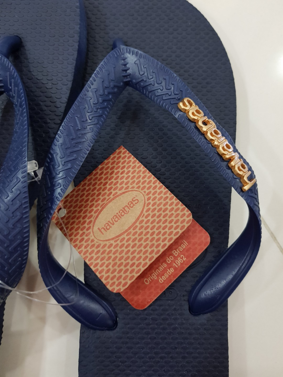 e0345c6d1fe4 Navy Havaianas Slippers with gold metallic logo
