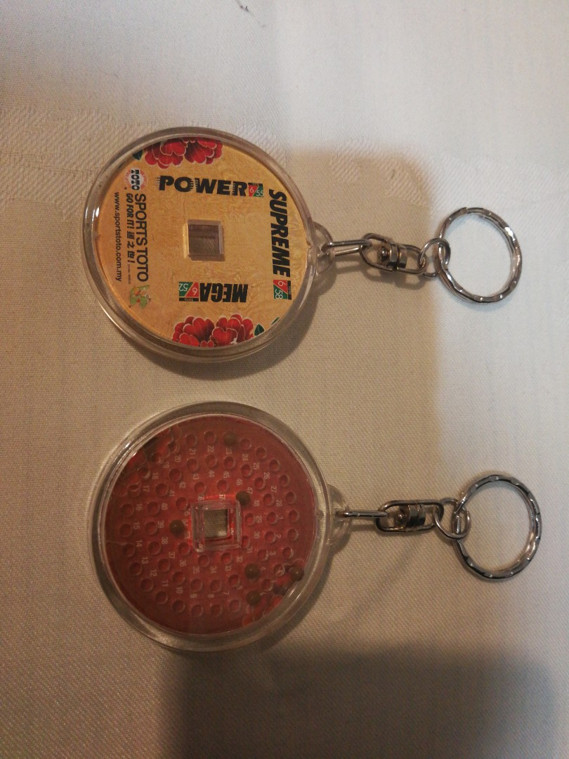 Sports toto key chain, Antiques, Vintage Collectibles on Carousell