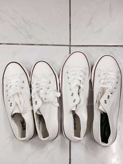 Couple white converse style shoes