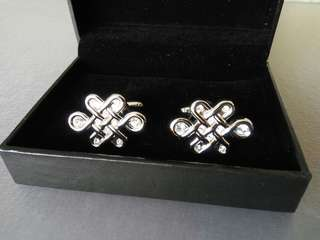 Auspicious cufflinks with clear stones