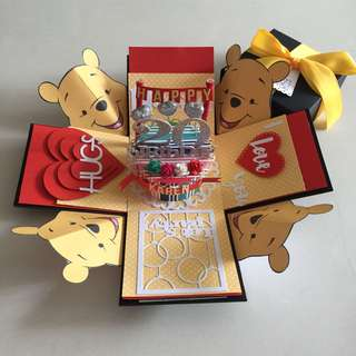 Pooh bear explosion box with cake & 8 personalised photos in red & yellow