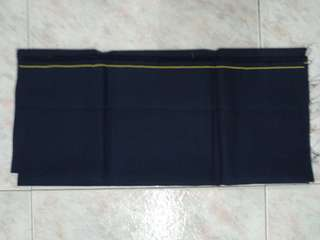 New dark blue fabric w yellow line. Not cotton.