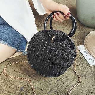 Round black bag