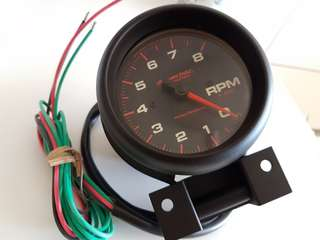 "Autometer Screamin' Eagle 5"" tachometer (very rare)"