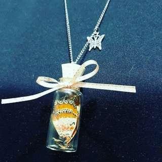 Bottled butterfly necklace