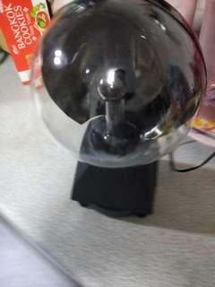 Lightning globe with hand or finger sensor