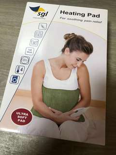Heating pad for soothing pain relief